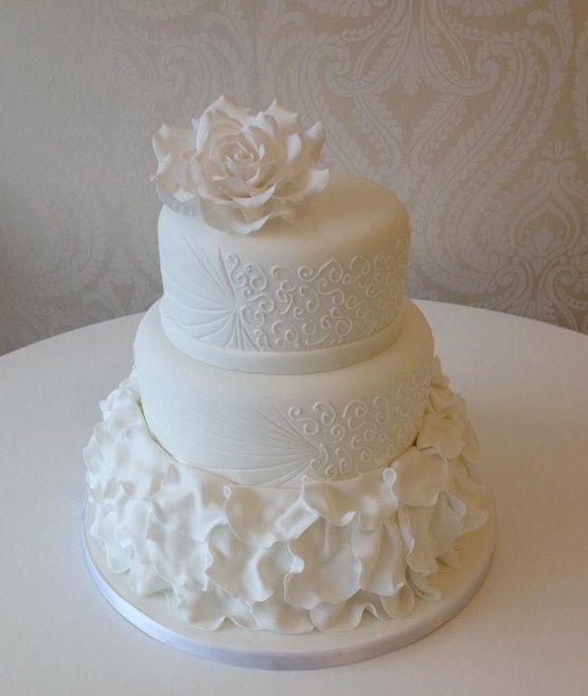 White Swirls And Ruffles Wedding Cake