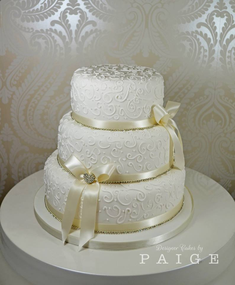 Piped Swirls And Ribbons Wedding Cake